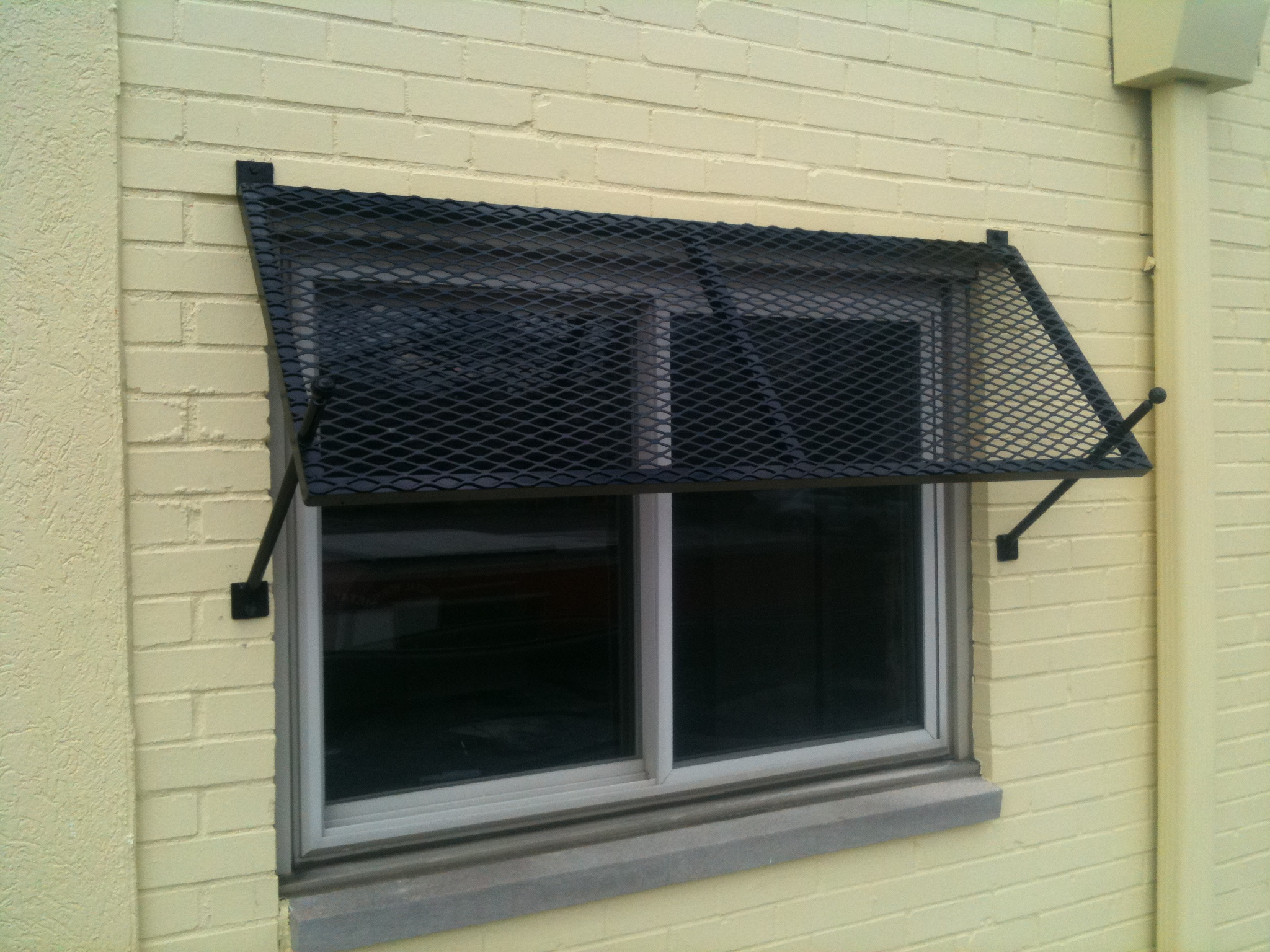 on manufactured commercial a metal copper htm from installed awnings building permanent awning